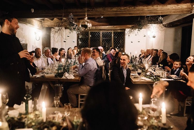 Small intimate reception for winter celebration with foliage decor and candlelight