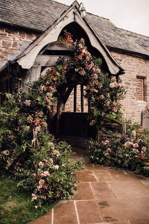 Beautiful wedding flowers at church entrance