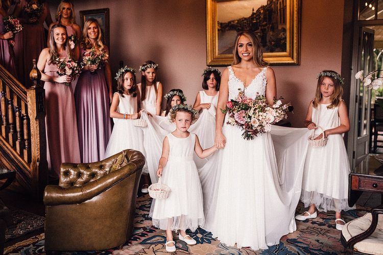 Bride with flower girls and pink bridesmaid dresses