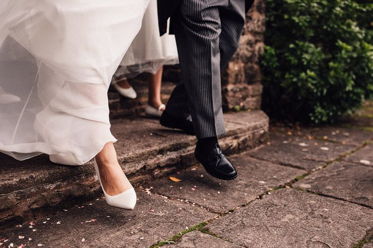 White wedding shoes for bride at Dewsall Court