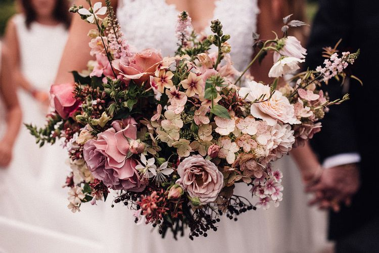 Blush bouquet for bride at Dewsall Court wedding