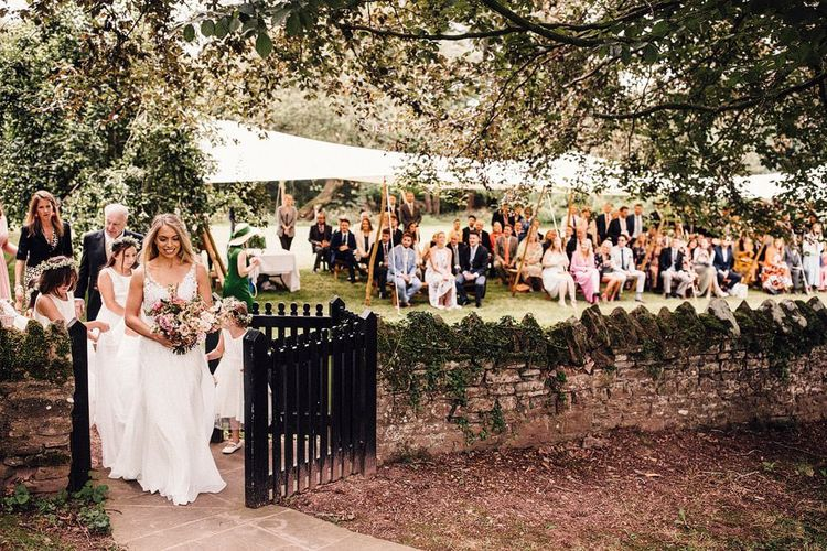 Bride makes her way to small church ceremony