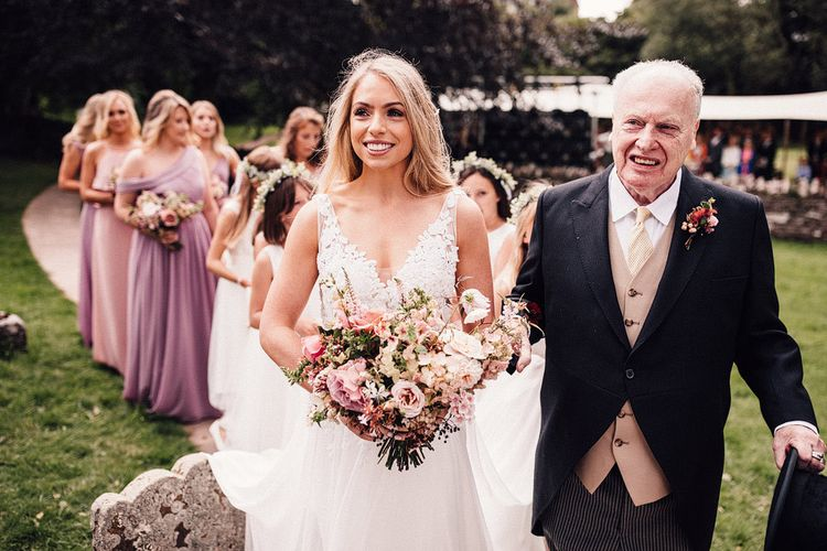 Bride at Dewsall Court wedding in lace bride dress