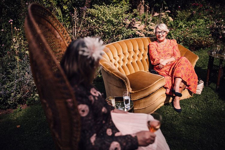 Guests enjoy outdoor drinks at Dewsall Court wedding