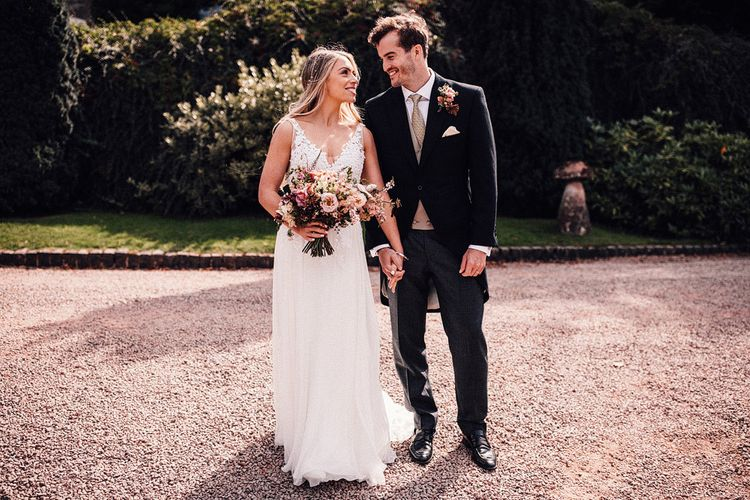 Bride and groom at Dewsall Court wedding