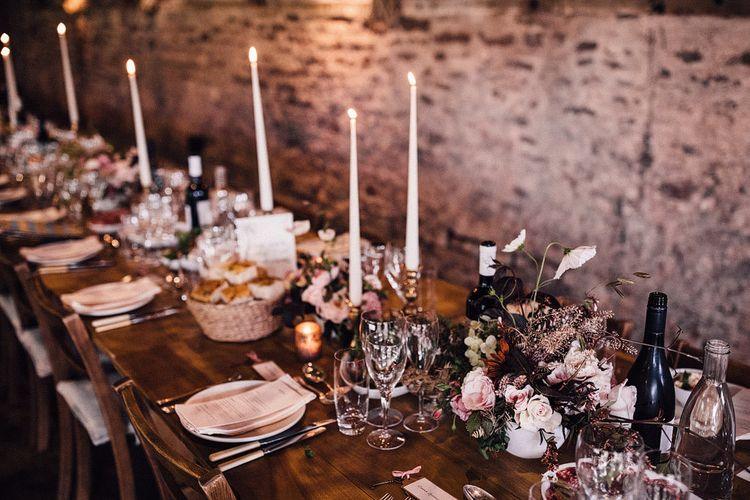 Tall candles and blush flowers for wedding table decor at Dewsall Court