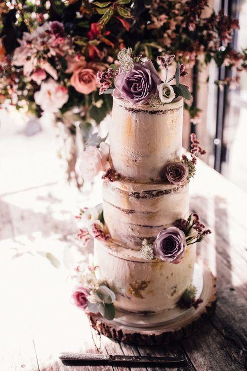 Semi-naked wedding cake with pink flower decor