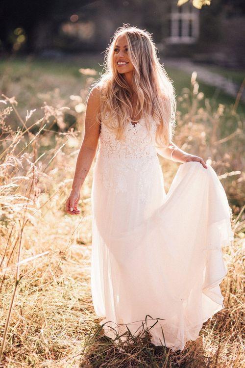 Bride wearing lace Donatella Piccarreta wedding dress