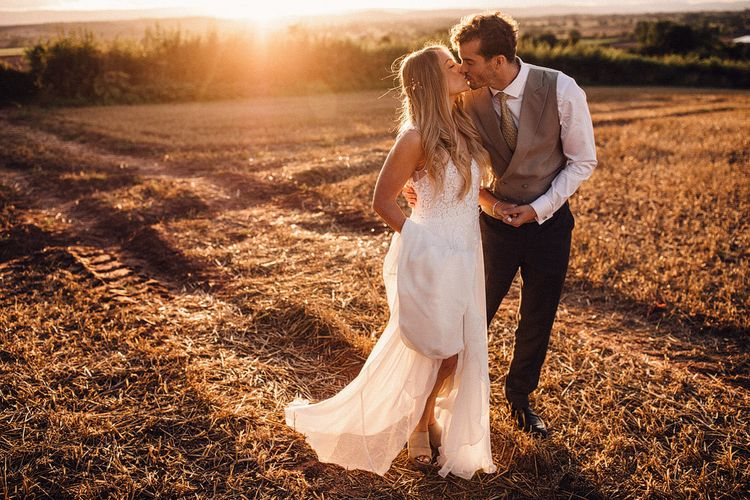 Bride and groom during summer wedding at Hereford venue