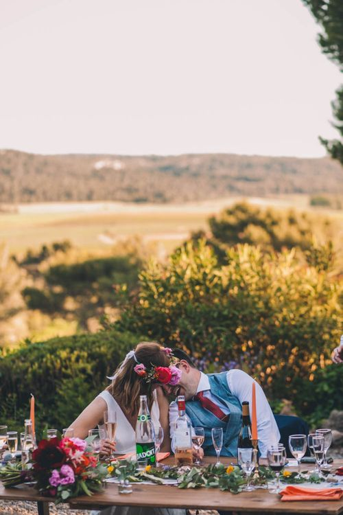 Bride In Flower Crown and Groom In Front Of Amazing View