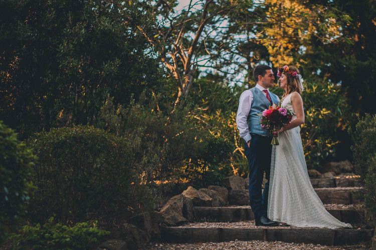 Bride and Groom In French Villa Grounds With Flower Crown For Bride