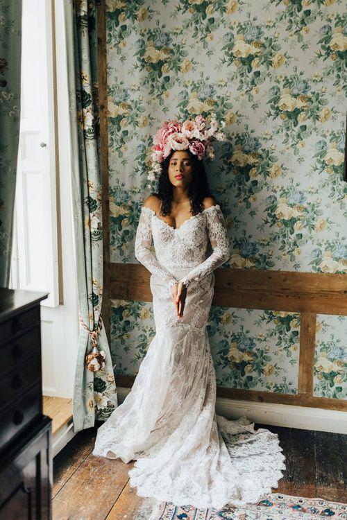 Lace off the shoulder wedding dress at Chiddingstone Castle