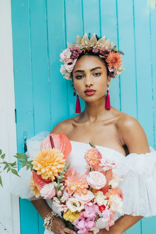 Colourful wedding flower crown and bridal bouquet