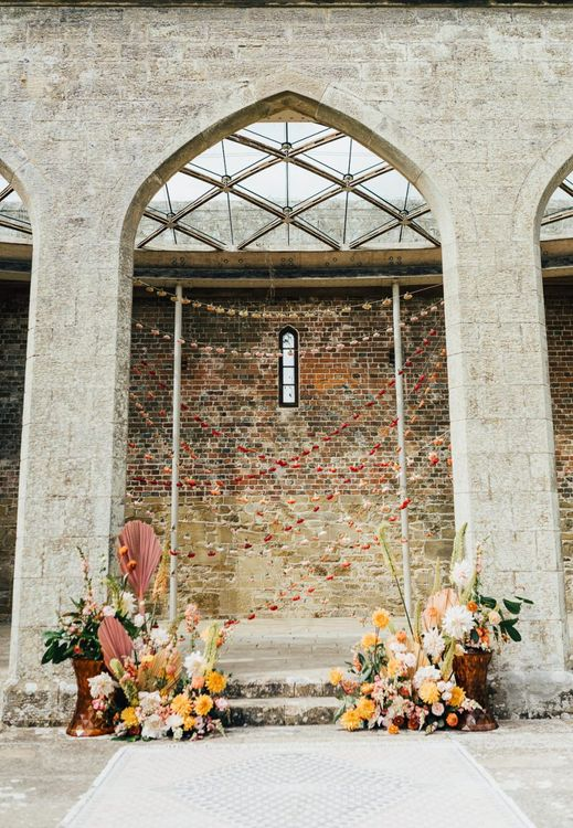 Altar decor at Chiddingstone Castle with string flower heads and floral arrangements