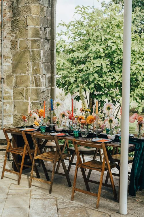Chiddingstone Castle wedding reception table decor with colourful flowers