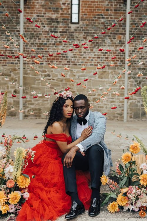Intimate portrait in front of strung up flower heads at Chiddingstone Castle