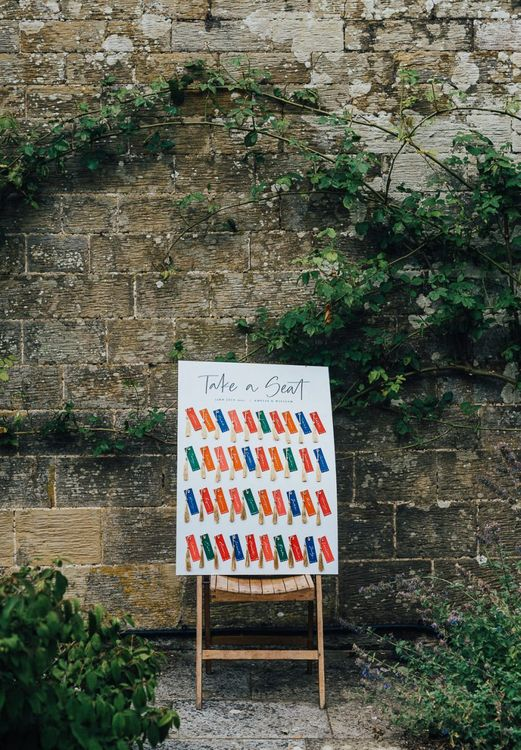 colourful Seating chart with name tags and tassels