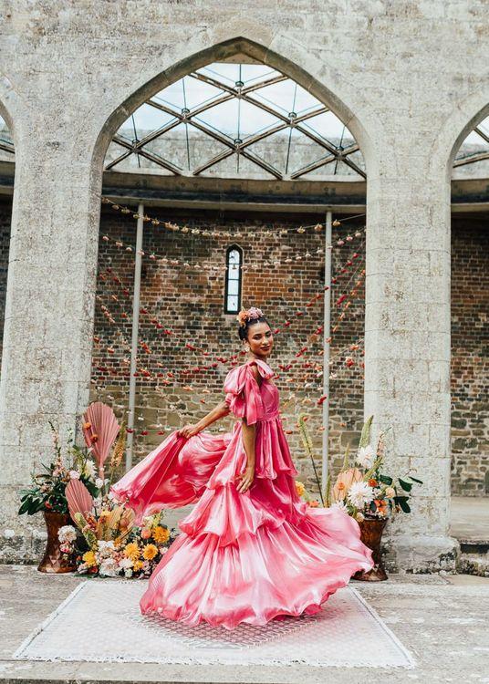 bride in layered silk Emma Beaumont wedding dress at Chiddingstone Castle