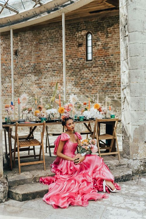 black bride sitting by the outdoor tablescape at Chiddingstone Castle