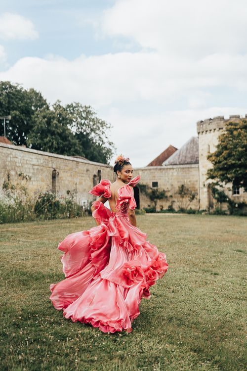 black bride in pink wedding dress at Chiddingstone Castle