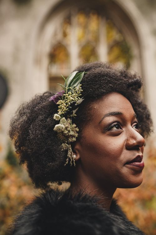 Beautiful black bride with afro hair and fresh flowers