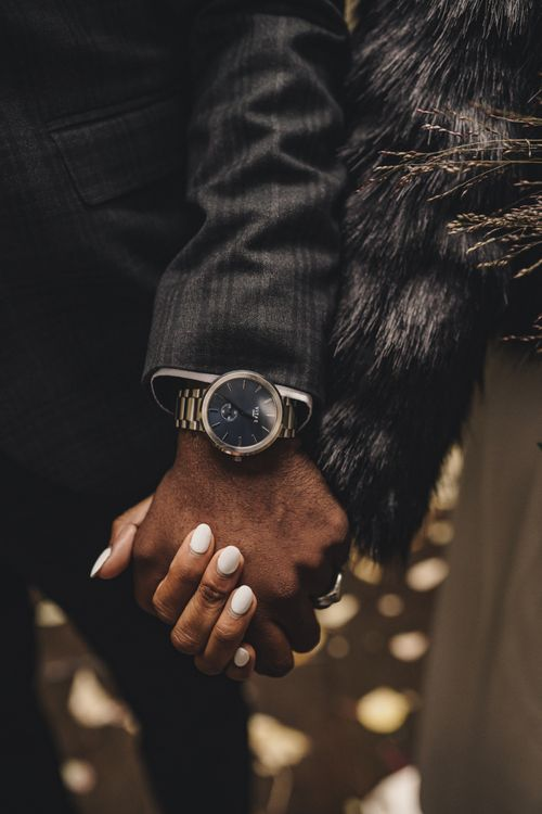 Groom wearing a Vitae watch with black face