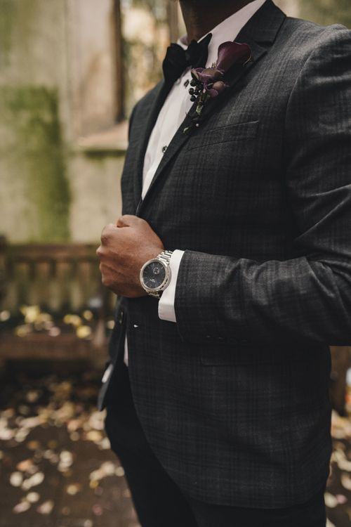 Groom in check wedding suit and Vitae watch