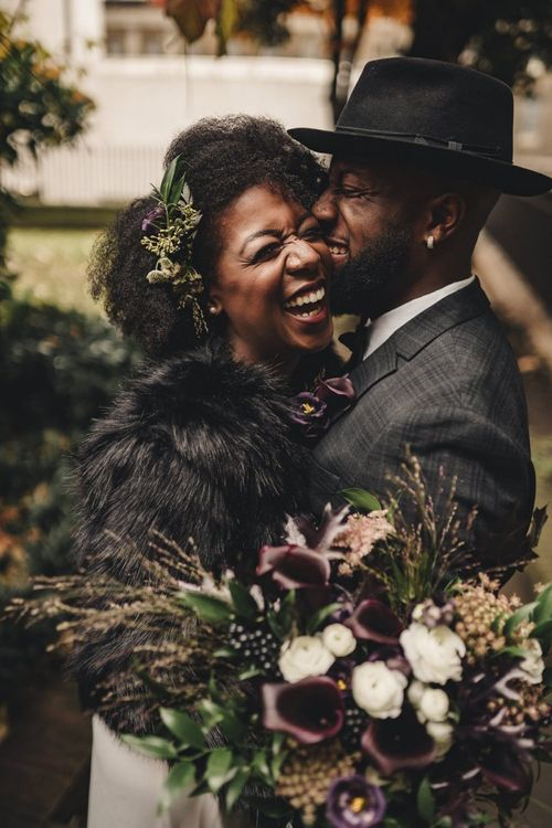 Intimate wedding photography with bride and groom laughing together