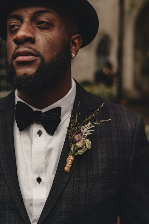 Stylish grooms buttonhole hole tied with string