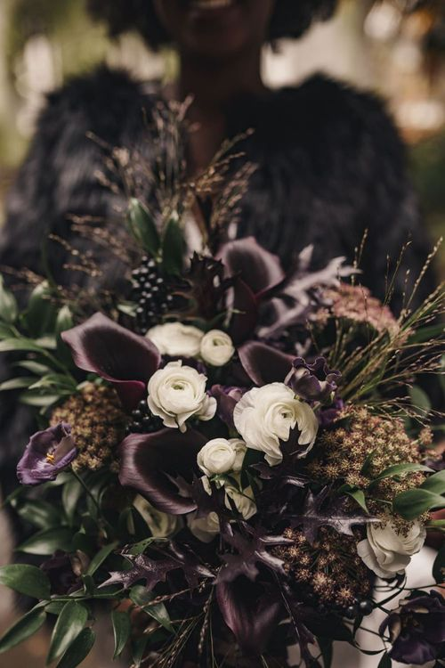 Black calla lily and white ranunculus wedding bouquet