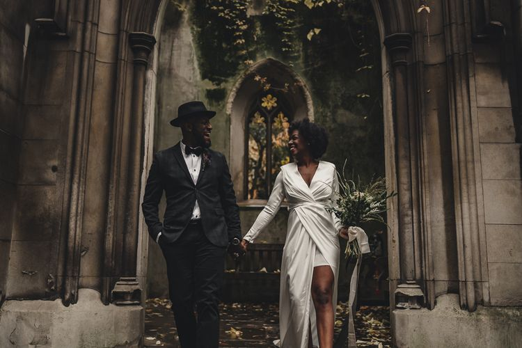 Stylish bride and groom at St Dunstan in the East
