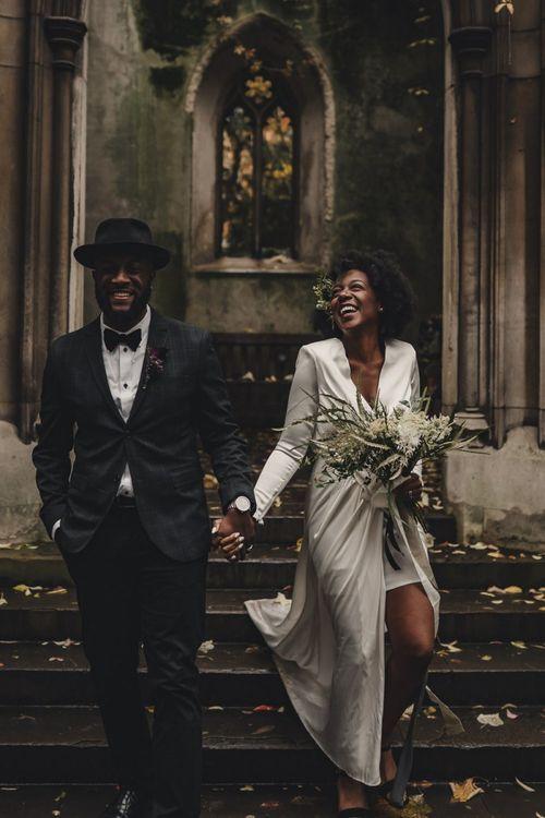 Happy bride and groom in black tie attire for London wedding