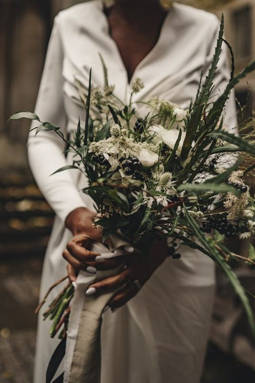 Green and white wedding bouquet tied with ribbon