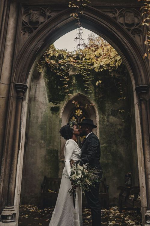 Bride and groom embracing at St Dunstan in the East