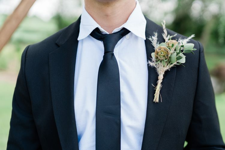 Groom in Black suit and Tie with Foliage and Pampas Grass Buttonhole