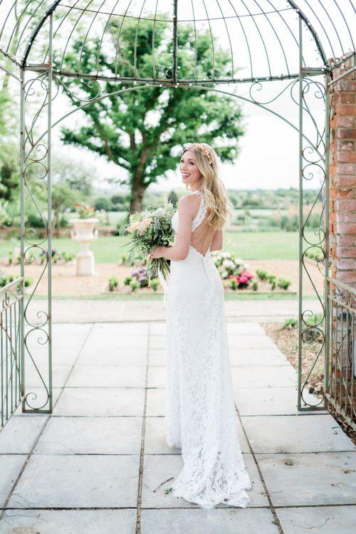 Bride in Key Hole Back Lace Watters Wedding Dress with Long Wavy Hair