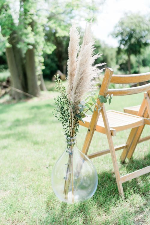 Pampas Grass and Foliage Sprigs Lining The Aisle