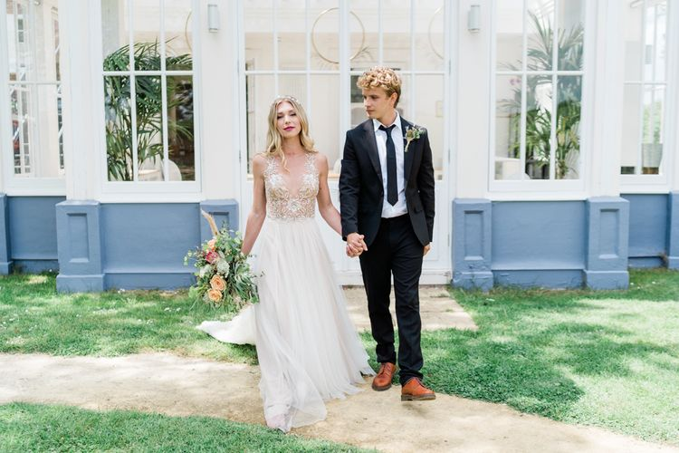 Bride in Watters Wedding Dress with Beaded Bodice and Tulle Skirt