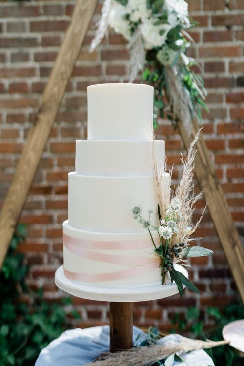 Four Tier White Wedding Cake with Ribbon and Pampas Grass Detail