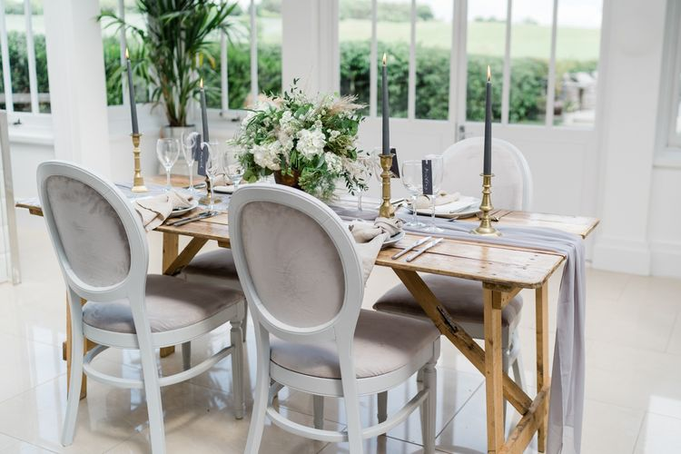 Elegant Grey and White Tablescape Decor with Taper Candles and Linen