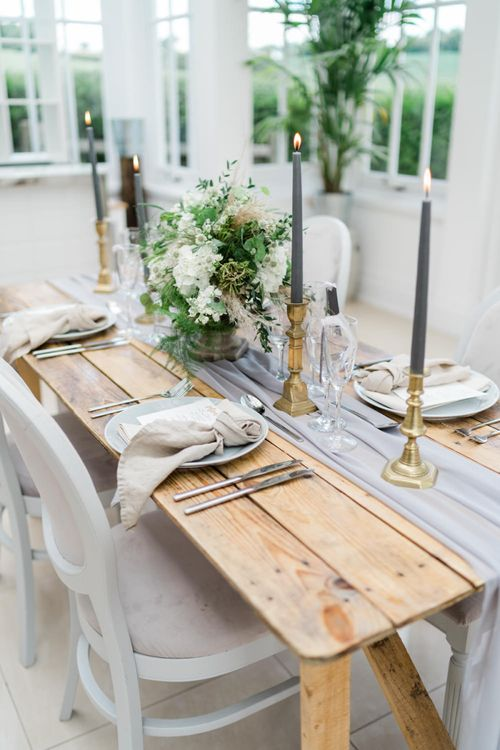 Wooden Table with Grey and Gold Table Decor