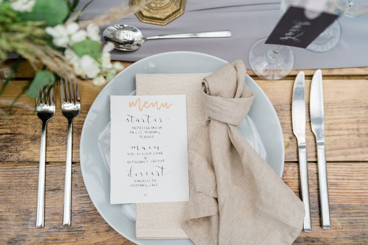 Elegant Place Setting with Grey Tableware, Linen Napkin and Script Menu Card
