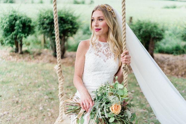 Bride in Lace Halterneck Wattens Wedding Dress and Gold Hair Vine