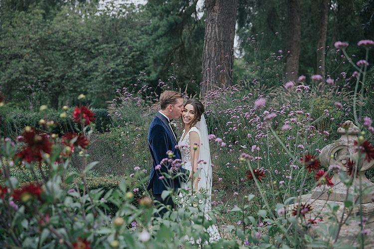 Bride and Groom in Flower Meadow