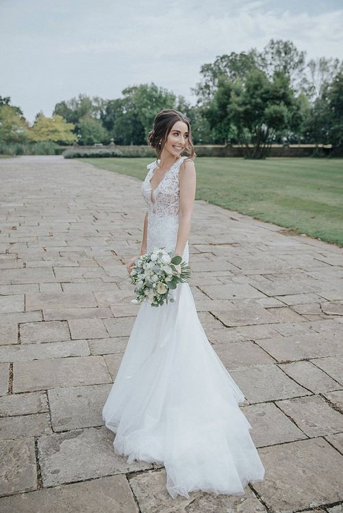 Bride in Riki Dalal Wedding Dress with lace Detail