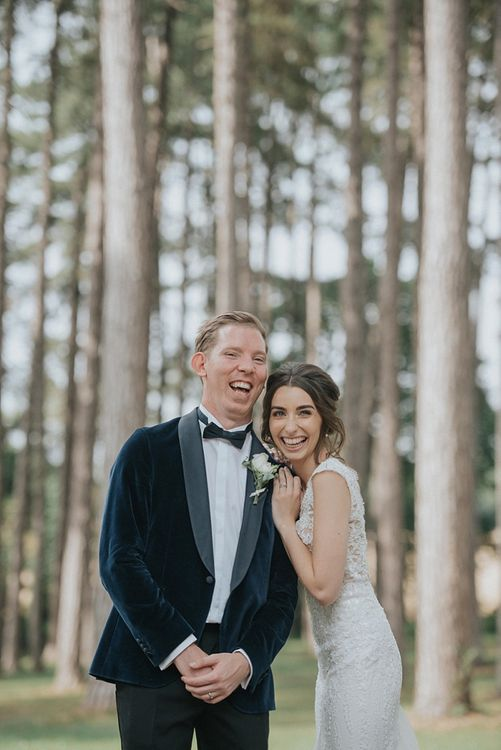 Groom in Tux With Bow Tie And Velvet Jacket
