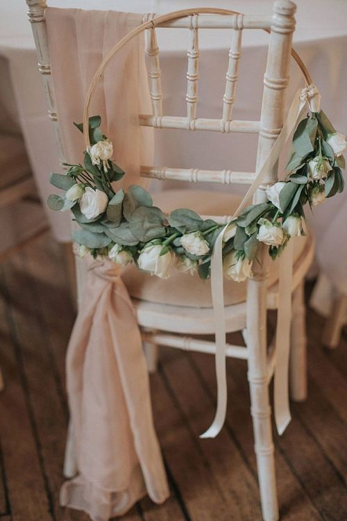Wedding Hoop Bouquet in White Hanging on Chair Back