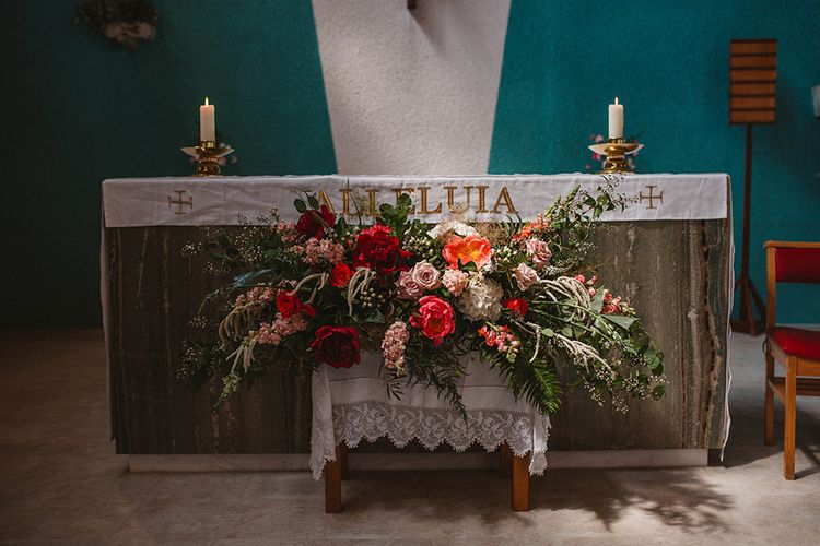 Red & Pink Church Floral Arrangement | Contemporary Wedding at Industrial Venue 92 Burton Road, Sheffield | Maytree Photography