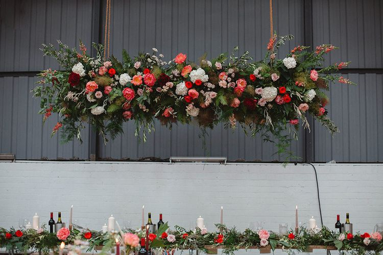 Hanging Red, Pink & Foliage Floral Installation | Contemporary Wedding at Industrial Venue 92 Burton Road, Sheffield | Maytree Photography