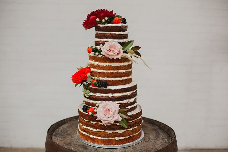 Naked Victoria Sponge Wedding Cake with Red & Pink Flower Decor | Contemporary Wedding at Industrial Venue 92 Burton Road, Sheffield | Maytree Photography